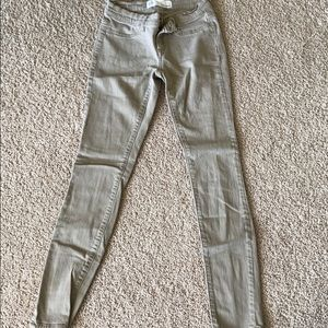 Khaki colored jeggings.